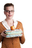 Teacher with books and apple. Attractive teacher carries books and an apple on white background Royalty Free Stock Photography
