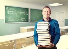 Teacher and books Stock Image