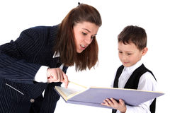 Teacher and boy with book Stock Image