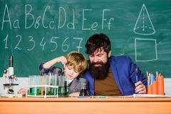Teacher and boy chemical laboratory. Knowledge day september holiday. Basic level chemistry knowledge. Study chemistry stock photography