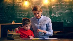 Teacher and boy are engaged in a student room. Learning concept. Teacher and student. Back to school. stock video