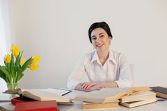 Free Teacher Business Lady Reads Books In The Office Stock Photos - 109695343