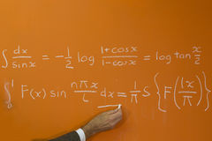 Teacher and calculus formula Royalty Free Stock Photo