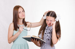 Teacher calms the student did not do their homework Stock Photos