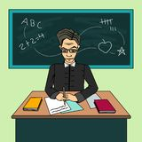 Teacher Cartoon Character, sitting at the desk in the classroom royalty free stock photos