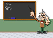 Teacher at chalkboard Stock Photo