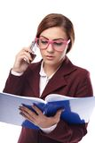 Teacher checking the class book and talking to the phone Royalty Free Stock Photo