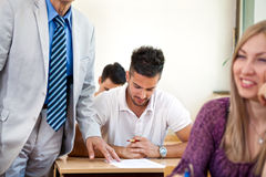 Teacher checking student work Royalty Free Stock Images