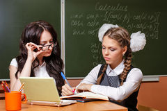 The teacher checks the decision lesson from a student. Royalty Free Stock Photography