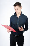 Teacher checks the test. School and learning. Man with the red tablet Stock Image