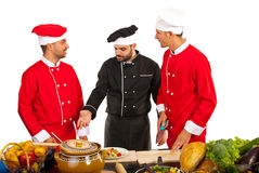 Teacher chef with students chefs Royalty Free Stock Image