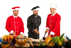 Teacher chef with students in kitchen Royalty Free Stock Images