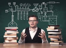 Teacher at chemistry class Stock Images