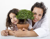 Teacher child plant. Teacher pupil  and small poted tree Royalty Free Stock Image