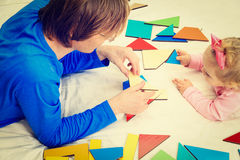 Teacher and child playing with geometric shapes Royalty Free Stock Photography