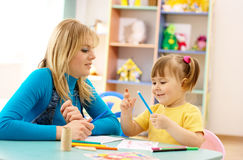 Teacher with child in preschool Royalty Free Stock Photos