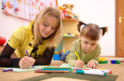 Teacher with child in preschool Royalty Free Stock Photos