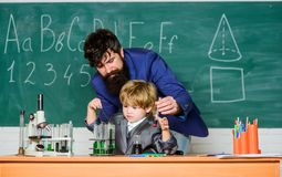 Teacher and child school classroom. Chemistry lesson. Lab experiment. Primary school. Basic education. Childhood royalty free stock image