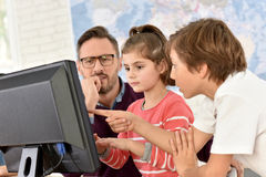 Teacher and children in classroom Royalty Free Stock Images
