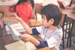 Teacher and children drawing in kindergarten art classroom. Teacher and children are drawing in kindergarten art classroom royalty free stock image