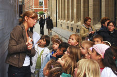 Teacher and Children field trip. Picture of a field trip showing the teacher guiding the children royalty free stock image