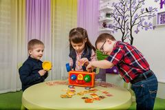 Children play board games