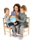 Teacher with children studying a globe Royalty Free Stock Photo