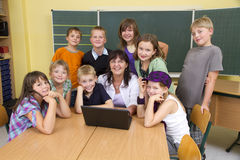 Teacher and children Stock Images