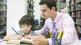 Teacher and chirld student learning and drawing royalty free stock image