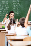Teacher chooses pupils to answer the question Royalty Free Stock Photo