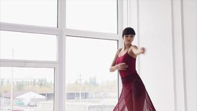 Young, professional dance teacher performs elegant movements in the dance hall stock video