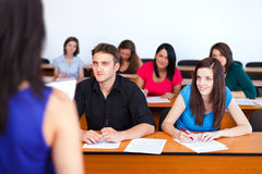 Teacher and the Class. Kind students looking attentively at their teacher Stock Image