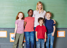Teacher with class of students in school stock photography