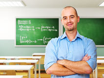 Teacher in classroom. Young teacher with book in 3d classroom royalty free stock photos