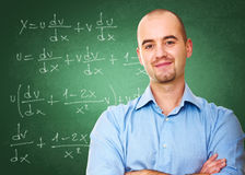 Teacher in classroom Stock Photo