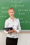 Teacher in classroom Royalty Free Stock Photos