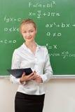 Teacher in classroom Royalty Free Stock Photos