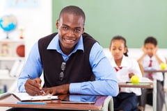 Teacher in classroom Royalty Free Stock Photo