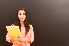 Teacher in the classroom. The teacher in the classroom on blackboard background Royalty Free Stock Images