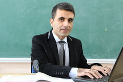 The Teacher in the classroom. Royalty Free Stock Photography