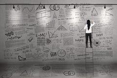 Teacher climb to write on whiteboard Stock Photography