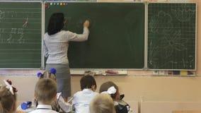 Teacher close to blackboard stock video footage