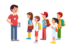 Teacher or coach talking to a group of kids Stock Photography
