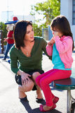 Teacher Comforting Upset Elementary School Pupil Stock Photography