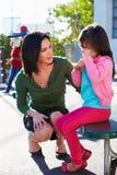 Teacher Comforting Upset Elementary School Pupil Stock Photography