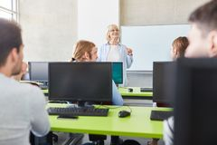 Teacher in computer course Stock Images