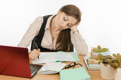 Teacher concentration checks notebook students Stock Images