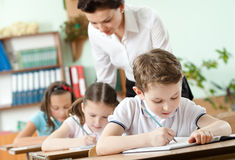 Teacher conducts the task performing royalty free stock photography