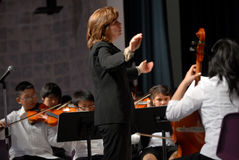 Free Teacher Conducts The Orchesta Royalty Free Stock Images - 17194829
