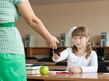Teacher is confiscating mobile phone at lesson Royalty Free Stock Photography